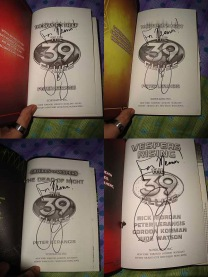 My copies of The 39 Clues, signed by Peter Lerangis