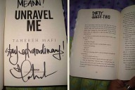 "My copy of ""Unravel Me"", signed and...uhhh...defaced by Tahereh Mafi. ;)"